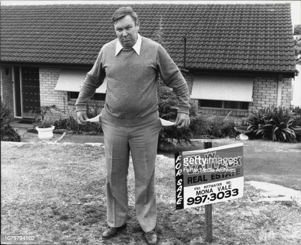 Mr David Ellis displays his empty pockets beside his for sale sign outside his Narabeen home. July 3, 1982. .