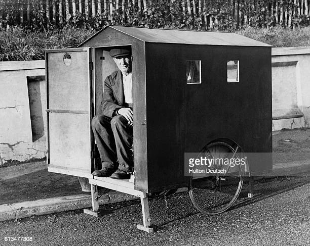 Mr David Weatherhead an unemployed shipyard worker from Sunderland sits in the doorway of his small mobile home which he has built to enable himself...