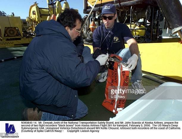 Mr Deepak Joshi Of The National Transportation Safety Board And Mr John Scarola Of Alaska Airlines Prepare The Second Of Two Flight Recorders 'Black...