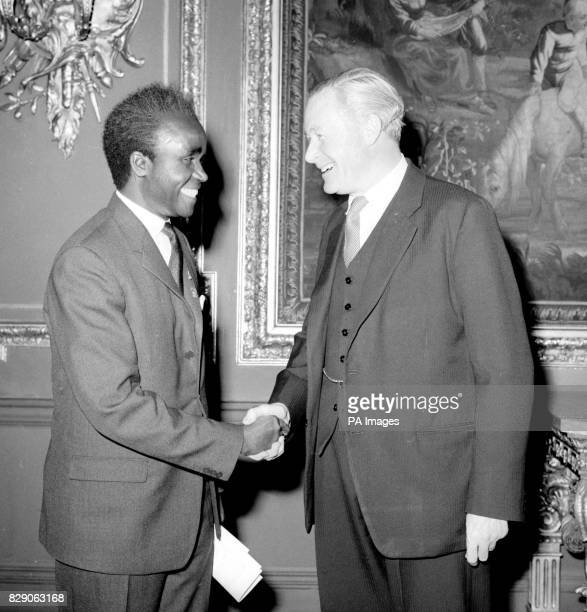 Mr Duncan Sandys Secretary of State for Commonwealth Relations and the Colonies shakes hands with Mr Kenneth Kaunda the first and present Prime...