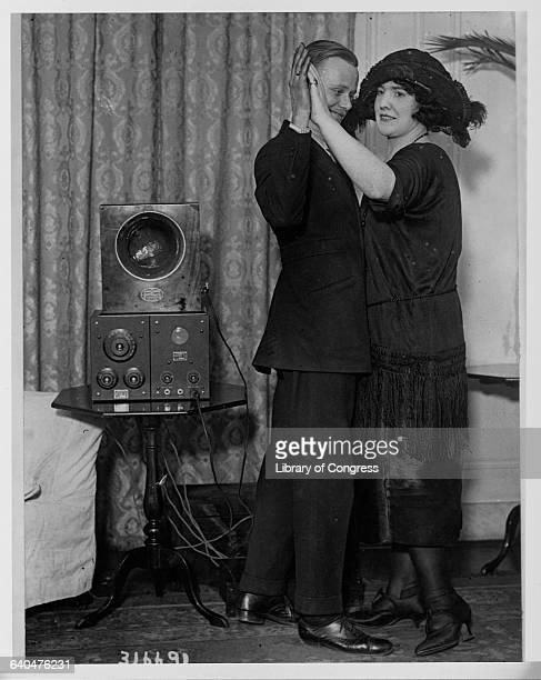 Mr EC Pickward dances the fox trot with a woman while listening to the newlyinstalled radio in New York's Hotel Vanderbilt | Location Hotel...