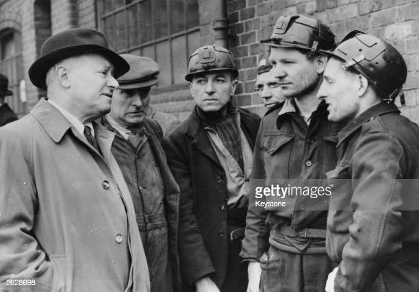 Mr Emmanuel Shinwell Defence Minister and Labour MP in Basington, Durham, hearing the latest details of the struggle to reach 60 miners trapped in a...