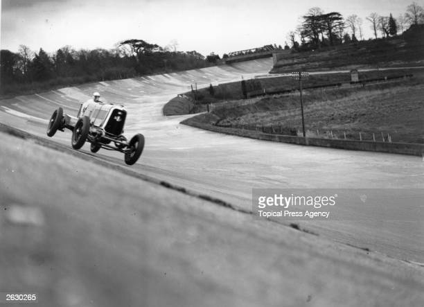 Mr G E T Eyston in Panhand for the British Empire Trophy Race held at Brooklands hitting a bump at 120 mph