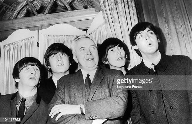 Mr Harold WILSON with the BEATLES who receive the award for Show Business Personnality of 1963 at the Dorchester Hotel in London
