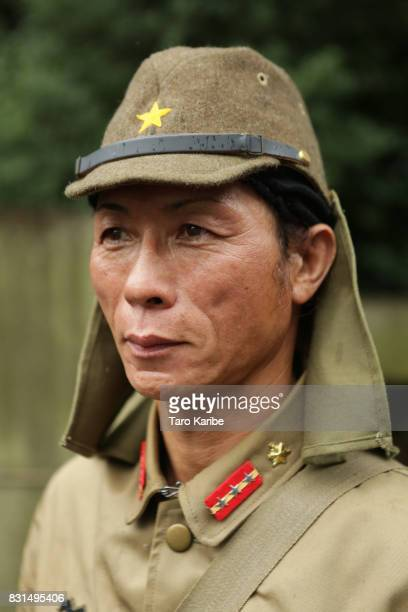Mr Hitomi wearing the old Japanese military uniform poses for a portraits on August 15 2017 in Tokyo Japan Japan marks the 72nd anniversary of the...