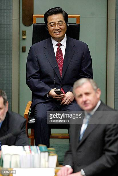 Mr Hu Jintao , President of the People's Republic of China, listens to a speech by the Leader of the Opposition Simon Crean , during a joint sitting...