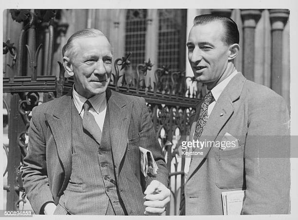 Mr Hugh O'Grady, with his son John, outside a London courthouse, where Hugh O'Grady is being sued by Christine Baskerville over to his alleged...