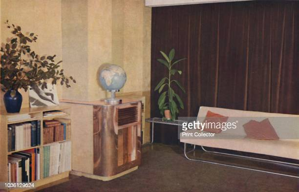 Mr J C Pritchard's sittingroom in the Isokon Lawn Road Flats London England designed by Wells Coates' 1936 Walls in panelled Venesta birch carpet by...