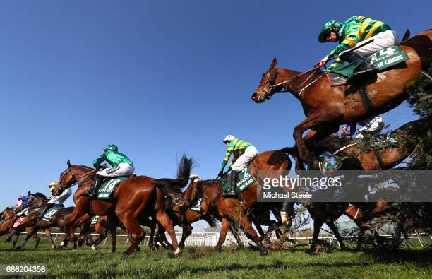 Mr J J Codd riding Cause of Causes takes Canal Turn during the 2017 Randox Heath Grand National at Aintree Racecourse on April 8 2017 in Liverpool...