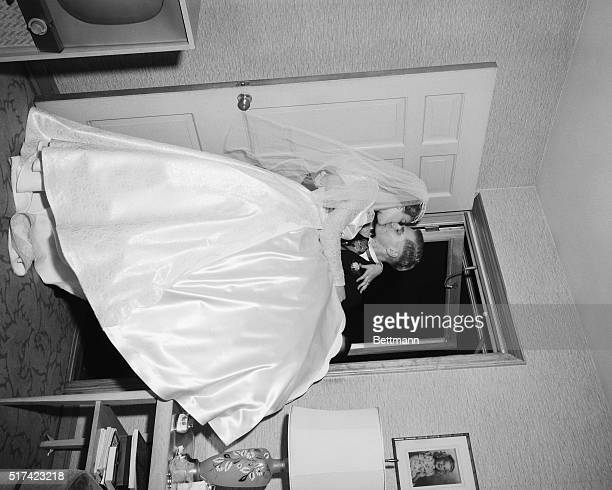 Mr Jay Tarasko carries his bride across the threshold into his hoome pausing to kiss the new Mrs Tarasko Undated photograph