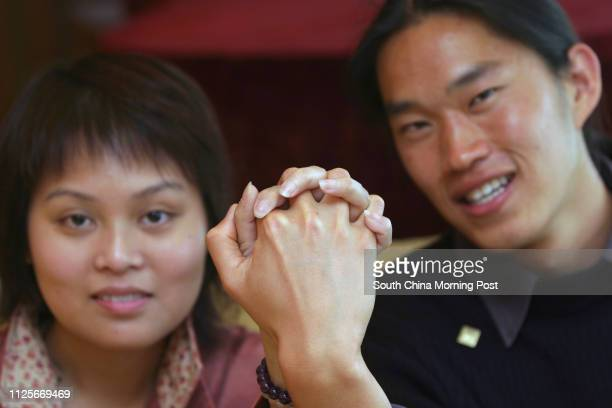 Mr Jeremy Jue R a marrow donor from San Francisico holds hands with the recipient Ms Chan Sukmei L Seven recovered bone marrow transplant recipients...