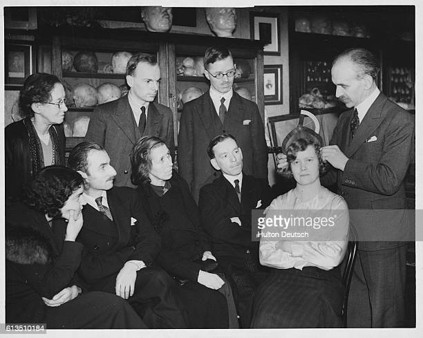 Mr JL Barr an instructor at the London branch of the British Phrenological Society demonstrates the use of callipers in assessing the energy or...