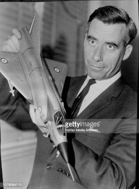 Mr JL Willis Director of the Museum of Applied Arts and Sciences Hirris St Sydney holding a scale model of the Bassault Mirage 1110 The model was...
