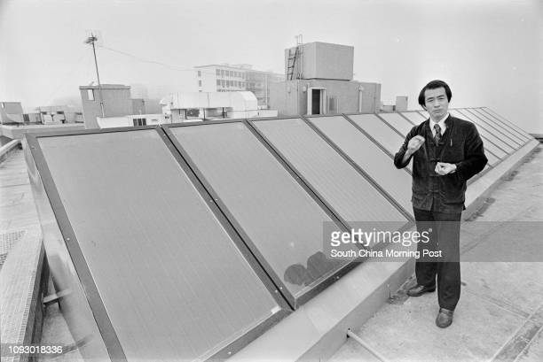 Mr Joe Choi showing a solar energy collector system designed by himself on the rooftop of a house in Mount Kellett Road The system is the first of...