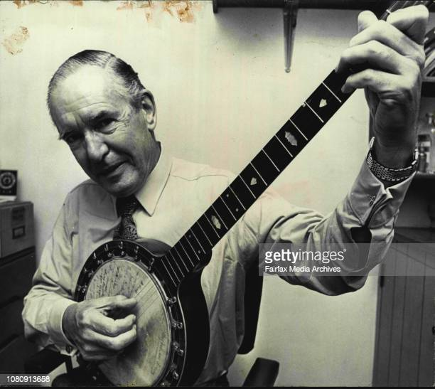 Mr. John Gilmore with the banjo he bought for $3 in 1949.On it are 22 signatures and he is trying to get in touch with these people.The people signed...