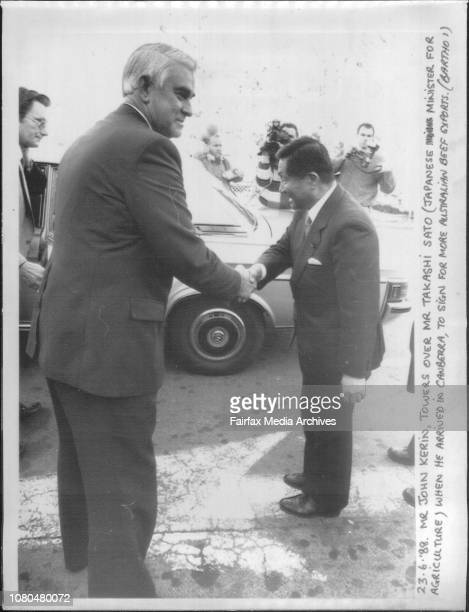 Mr John Kerin towers over Mr Takashi Sato when he arrived in Canberra to sign for more Australian Beef Exports June 23 1988