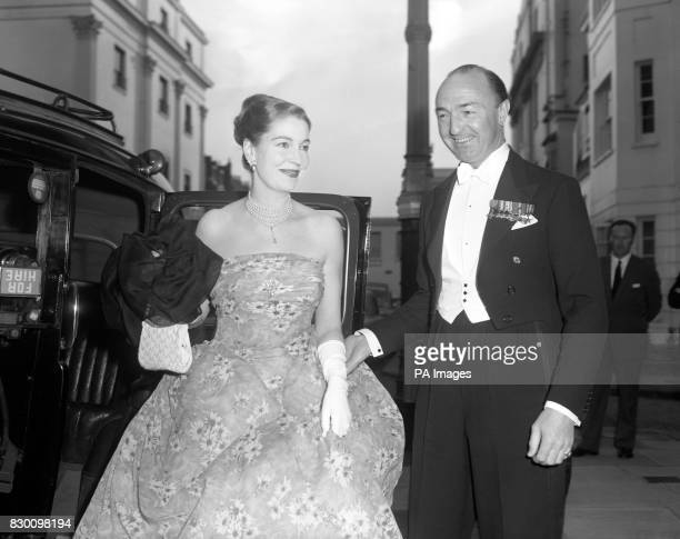 Mr John Profumo Minister of State for Foreign Affairs and his wife former actress Valerie Robson arrive at the home of Mrs John Ward for a dinner...