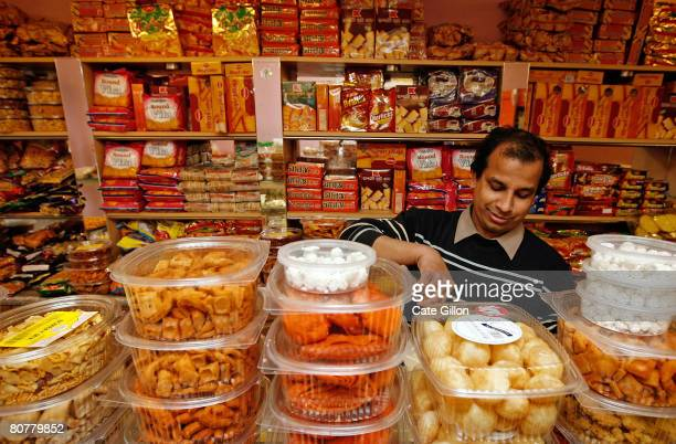 Mr Kalim serves treats in his Bangladeshi sweet shop 'Madhubon' on Brick Lane on April 19th 2008 in London England Tomorrow is the anniversary of...
