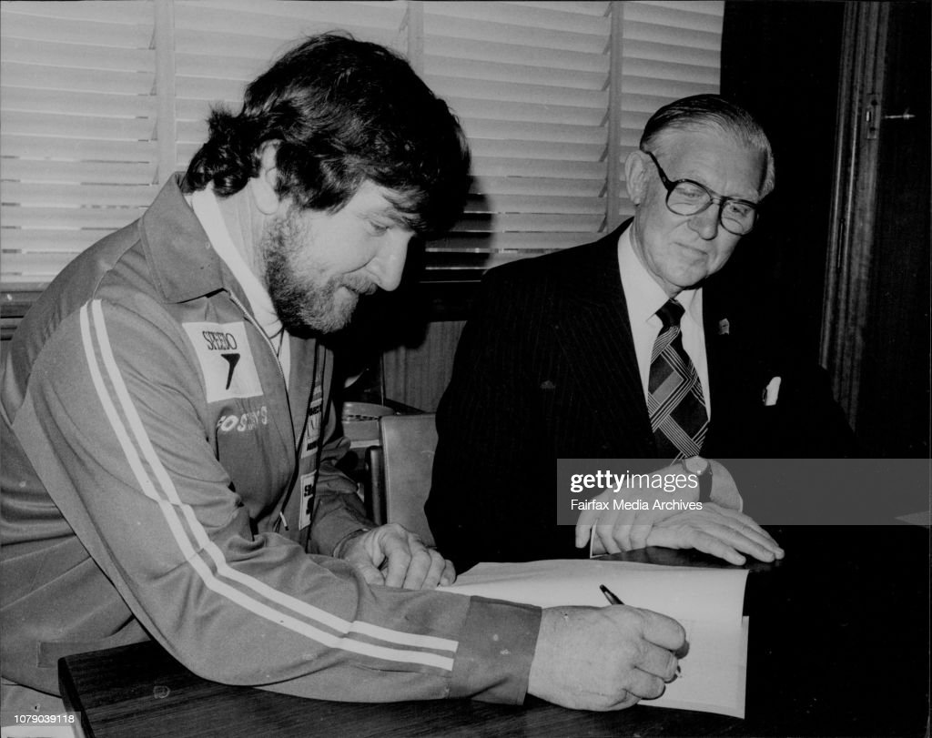 Mr Ken Warby (left) signs an agreement with Speedo Managing Director Mr Bill MacRae at their Artarmon offices.World Water Speed Record holder Mr Ken Warby pictured at Speedo Knitting Mills Pty Ltd, Artarmon where he today signed an agreement  for Sponsors : News Photo