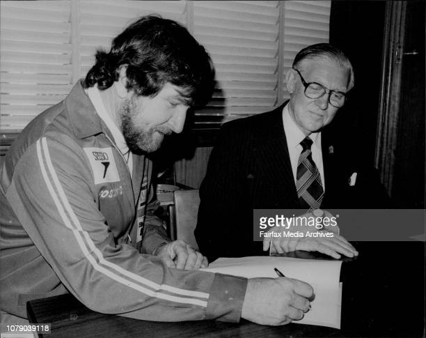 Mr Ken Warby signs an agreement with Speedo Managing Director Mr Bill MacRae at their Artarmon officesWorld Water Speed Record holder Mr Ken Warby...