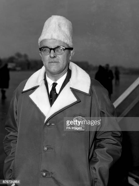 Mr Kenneth Duncan secretary of the British Olympic Association sports a 'MacmillaninMoscow' hat at London Airport before he flew to San Francisco on...