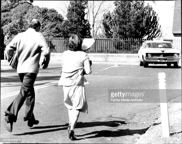 Mr Kevin Griffiths runs with his wife from the District Court today after being freed from gaol by Judge Goran The Full High Court yesterday ruled he...