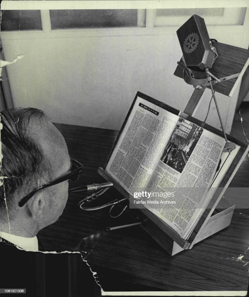"""Mr. L. Goodwin demonstrates """"Rotary"""" page turning machine for incapacitated people.A New Zealand idea to enable the physically handicapped or the paralysed to turn the pages of a magazine or book by breathing, sucking or moving a lever (pictured) has been : News Photo"""