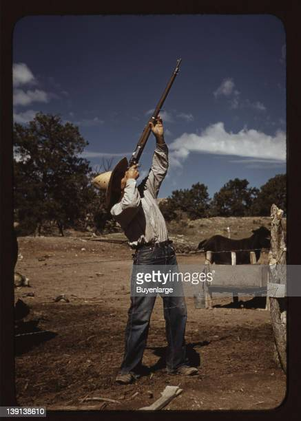 Mr Leatherman homesteader shooting hawks which have been carrying away his chickens Pie Town New Mexico 1940
