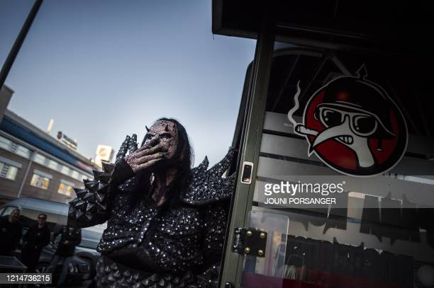 Mr Lordi of the Finnish hard rock band Lordi smokes a cigarette before the 3 hours Lordi Scream Stream Scarctic Circle Gathering gig in Rovaniemi at...
