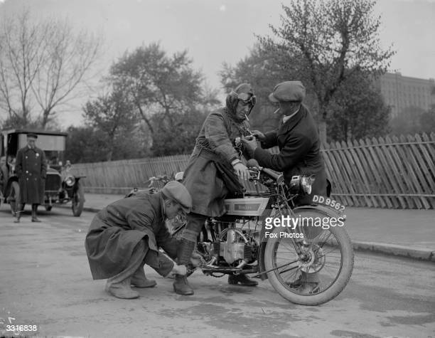Mr Lorraine is shackled to his motorbike by some enthusiastic supporters