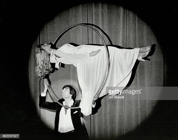 Mr Magic gives her career a lift Popular American illusionist David Copperfield passes a hoop around the elevated body of his elegant assistant...