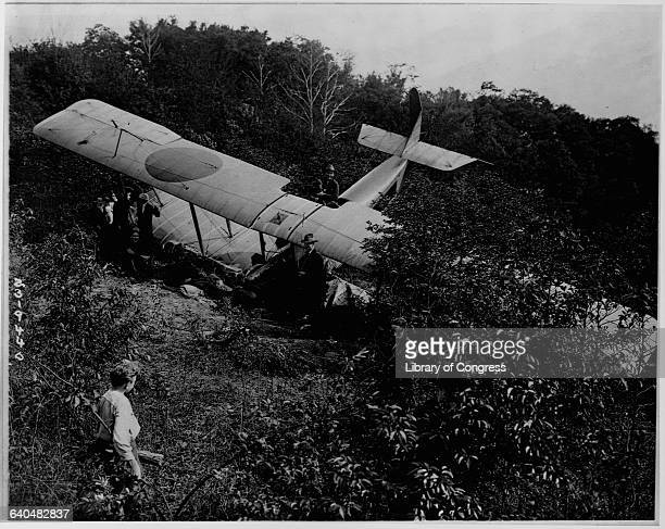 Mr McCall looks at the airplane known as a rum runner because it was carrying alcohol that crashed on his farm near Crotonville New York May 17 1922...