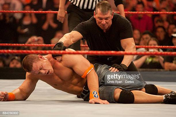 Mr McMahon tries to pin John Cena during WWE's Monday Night Raw at Rose Garden arena in Portland