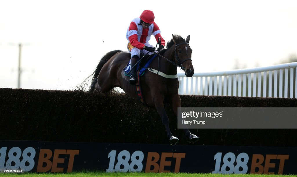 Mr Medic ridden by James Best jumps the last on their way to win during the Bet 10 Get 20 At 188Bet Handicap Chase at Exeter Racecourse on October 12, 2017 in Exeter, England.