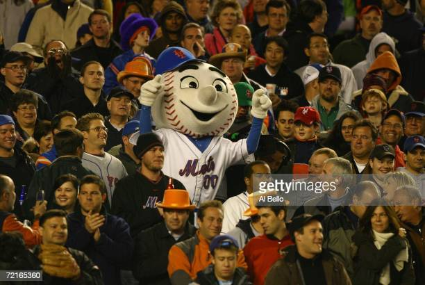 Mr Met of the New York Mets stands in the crowd during game two of the NLCS at Shea Stadium on October 13 2006 in the Flushing neighborhood of the...