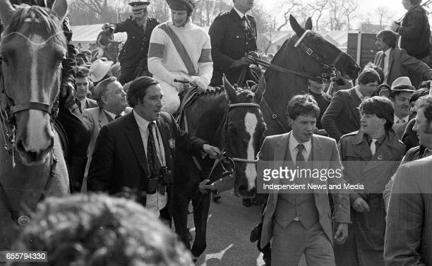 Mr Mick Embiricos owner of Aldaniti and Jockey Bob Champion enter the winners encloure after victory in the Sun Grand National Chase at Aintree