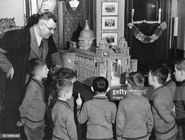 Mr Millikin shows boys a model of a cathedral Lancing House Preparatory School / Lowestoft 27th December 1934 Photograph