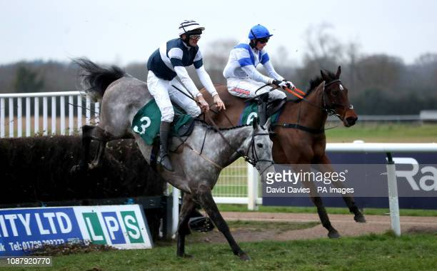 Mr Mix ridden by Stuart Robinson and Upswing ridden by Jack Andrews compete in the Overbury Stud Willoughby De Broke Open Hunters' Chase during...