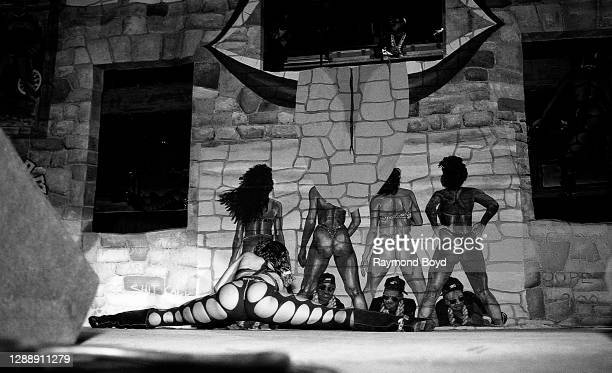 Mr. Mixx and a 2 Live Crew dancer performs at the International Amphitheatre in Chicago, Illinois in October 1989.