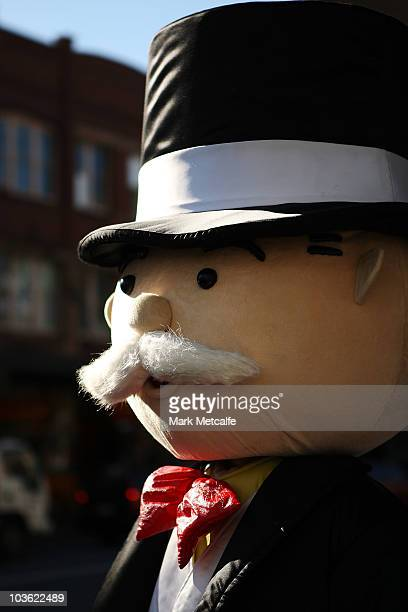 Mr. Monopoly hands out Monopoly notes to Sydneysiders on Oxford Street during Monopoly's 75th anniversary celebration on August 25, 2010 in Sydney,...