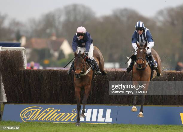 Mr Moonshie ridden by Henry Oliver jumps ahead of Teaforthree ridden by Tony McCoy in the The williamhill.com Feltham Novices Steeple Chase