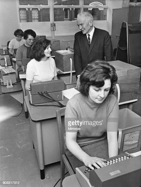 Mr Morris talks with operators at new computer centre, Liverpool, Circa 1970.