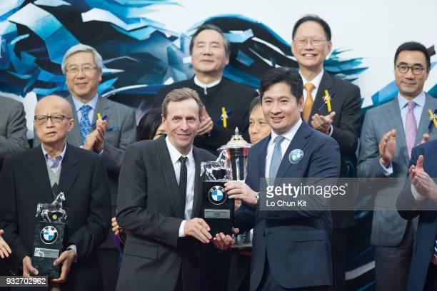 KONG – MARCH Mr Newman Tsang Managing Director – Hong Kong Macau BMW Concessionaires Ltd Sime Darby Motor Group Limited present souvenir to BMW Hong...