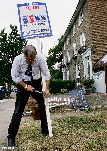 Mr Parvizi from Harmex Signs erects a for sale sign outside a property on June 10 2005 in London England Towards the end of 2004 the most hawkish...
