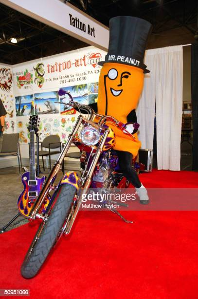 Mr Peanut rides Gibson Guitar Chopper at the Licencing Show 2004 at Jacob Javits Center June 8 2004 in New York City