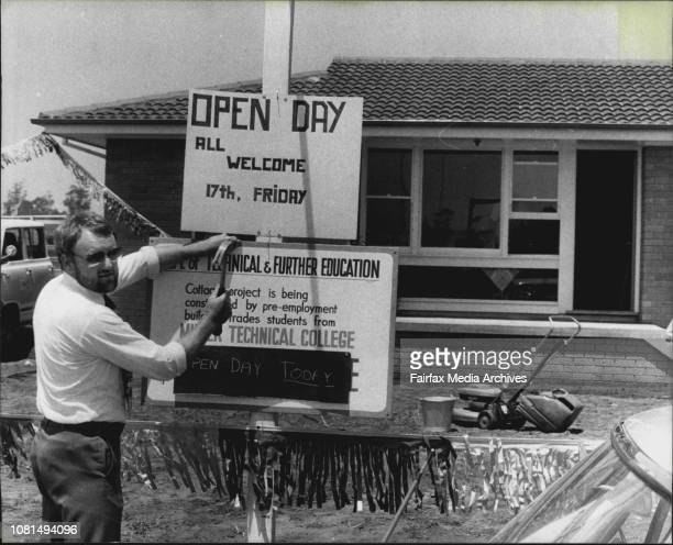 Mr Peter Lovelock a carpentry teacher errects the visitors' sign outside the house that Jack and Peter and Tom and Bob and Warren etc built November...