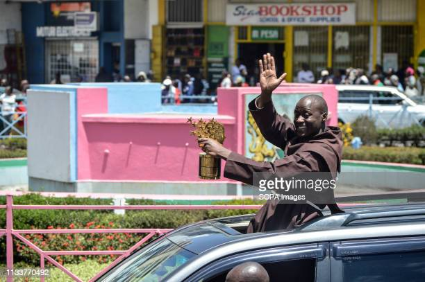 Mr Peter Tabichi who was named world best teacher is seen holding his trophy while greeting people when he arrived in Nakuru his home town where he...