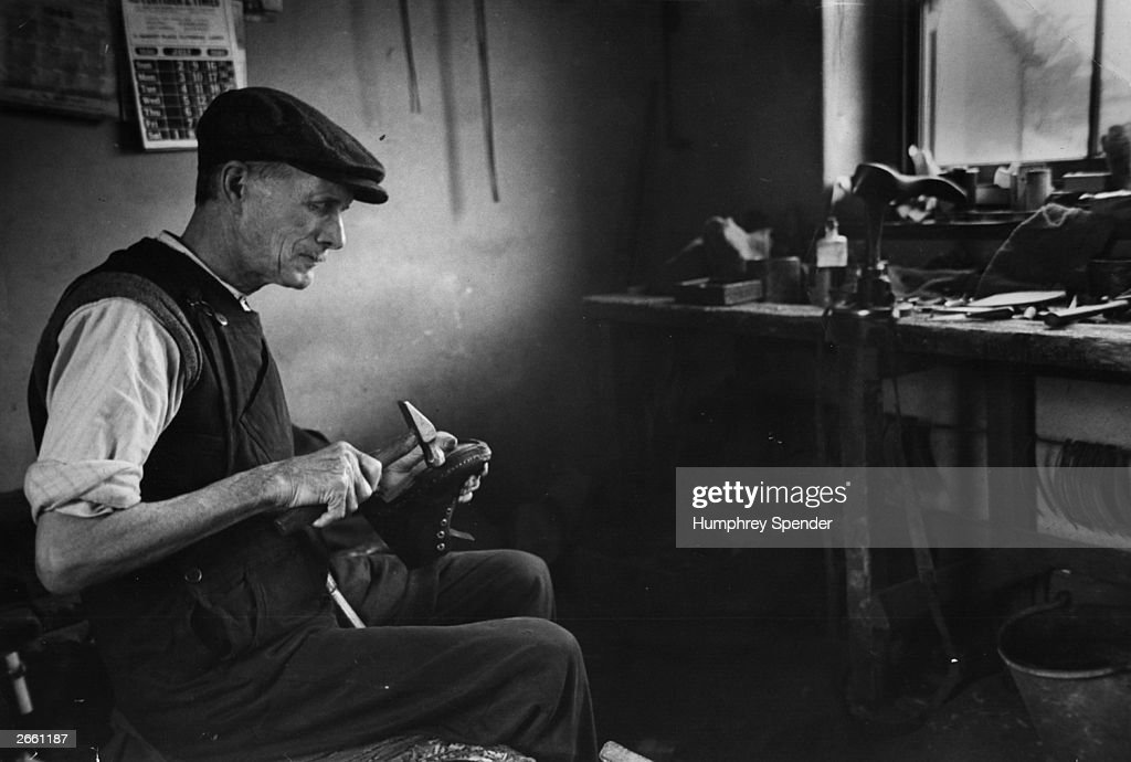 Mr Pollard, a shoe-maker, at work in his workshop in Yorkshire. Original Publication: Picture Post - 5124 - Country of the Dales - pub. 1950