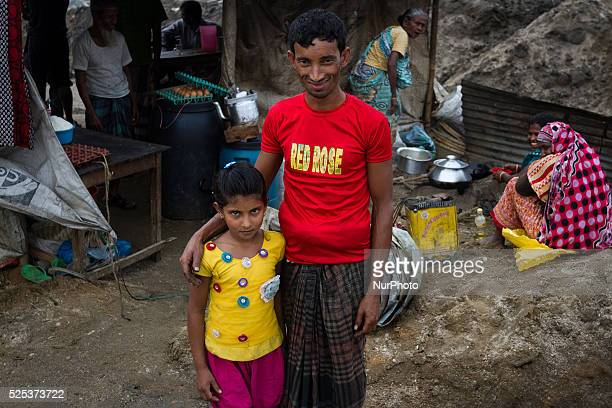 Mr Ramzan stands with his daughter named Ruma in front of their small tea stall inside stone extraction site on April 4 2015 in Jaflong Sylhet...