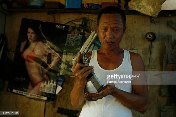 Mr Roberto making a 45mm semiautomatic gun similar to a Beretta in the clandestine gun manufacturing workshop in the jungle just outside Danao which...